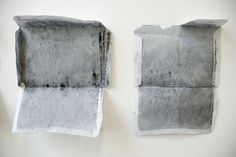 Marie Clerel - envelopes, charcoal, pins, French postal services (2010).  Ten envelopes, each containing a piece of charcoal, were sent to 10 people, who each then returned the envelope to the artist