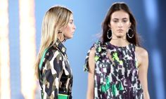 Donatella Versace mixes camouflage with leopard-print swirls and mines military garb and shades of khaki for the label's spring/summer collection.