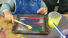 Screening old picture frames and using a  toothbrush to paint