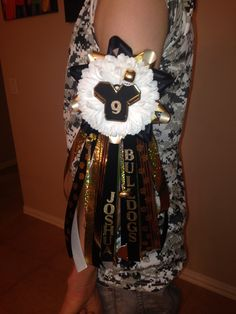 Mansfield PeeWee Football Association Garter.  12 inch ribbons, Team Name, Player Name, Jersey with number Trinket for center piece. By Aimee Howell 817-239-2615