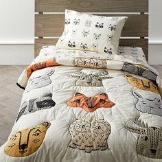 A crew of fanciful forest critters including foxes, raccoons and bunnies makes our woodland animal toddler bedding stand apart from the pack. Woodland Room, Toddler Rooms, Baby Boy Rooms, Toddler Bedding Boy, Toddler Bed Sheets, Boy Bedding, Toddler Beds For Boys, Comforter Sets, Kid Decor