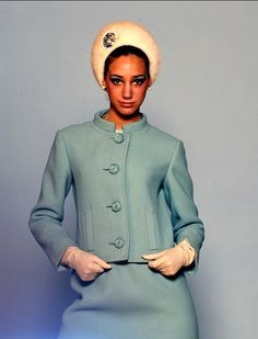 Marisa Berenson in suit by Seymour Fox, hat by Miss Alice and earrings by Mimi di N.  Photo by Bert Stern.  Vogue (unpublished), September 1965.