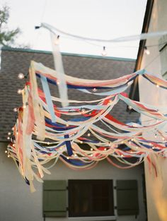 A canopy of red, white and blue streamers with lights.
