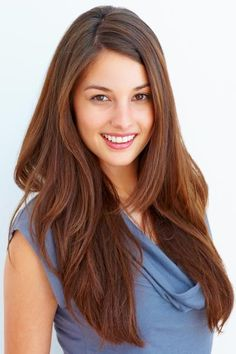 Hair texture is important to keep in mind for every haircut. Long angled layers thin out and add body to gorgeous thick hair. Here, textured layers begin at shoulder length, angling down to the longest points. This high volume hairstyle would look great cut into a U- or V-shape at the back.