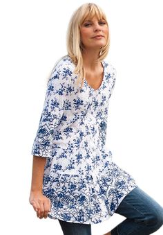 """This plus size floral tunic top with a flounced hem is airy, lightweight and ideal for spring, summer and fall. It compliments jeans and leggings perfectly. Great European style with your favorite comfort fit at all-American prices.  A-line silhouette tappers away from your waist, offering a generous sweep 32"""" gently grazes your mid thigh front can be buttoned or opened to a cool V-neck 3/4 bell sleeves are great for temperature control, armholes are roomy front pintucks, flocked ..."""