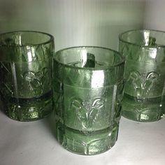 Suite de 3 tarros pulqueros poblanos (Chivos) en vidrio verde prensado reciclado en los 60's. Size: 11 x 11 x 8 cms / 4.2 x 4.2 x 3.5 inches. Prieguntar el Precio ~ Price Upon Request.
