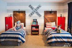 Love this boys room - especially the barn door headboards!