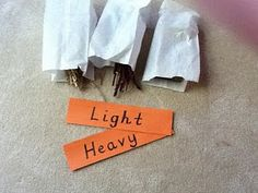 three little pigs maths - heavy and light and the need to heft or weigh objects