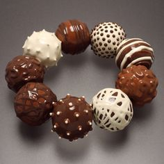 Sorry, no chocolate here...just a fun bracelet made with wood beads and paint by artist Lynn Christiansen. There is a necklace to match!  yum. www.facerejewelryart.com/artist.php?id=167