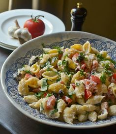 Pasta salad with roasted garlic, olives and tomatoes