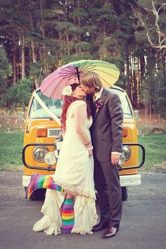 Rainbow wedding couple #boho wedding #rainbow umbrella bride