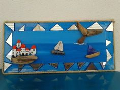 mirror pieces, driftwood, pebble houses n stone sail boats