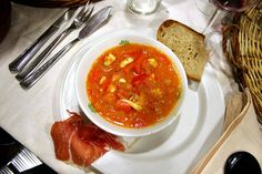 Sopa de Mariscos is a tomato-based seafood soup with clams, mussels, shrimp, squid, fish, and vegetables.