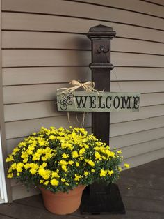 My front door welcome sign and post that I made