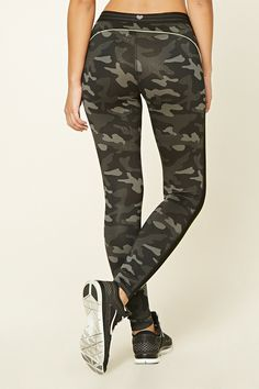 66091af29a72c An athletic pair of camo print leggings with contrast piping throughout, a  striped waistband,