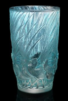 René Lalique  'Coqs et Plumes' a Vase, design 1928  frosted and polished glass, heightened with blue staining  15.2cm high, etched 'R. Lalique France'