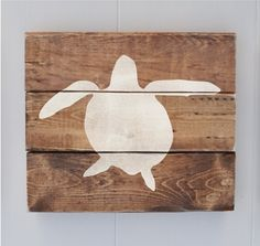 This sea turtle beach decor sign is an all wood sign that is made from stained rustic pine.    The sign measures approximately 10 tall x 11 wide x 1