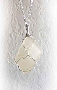 This handmade pendant features an almost diamond shaped piece of smooth translucent sea glass from Long Island. It's set in an artistic sterling silver wire wrap. Free US shipping. $48