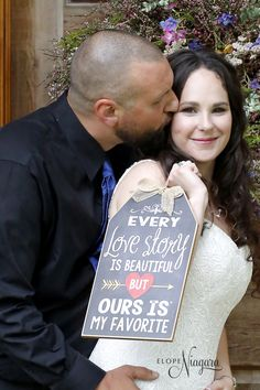 First kiss as husband and wife at the Little log wedding chapel in Niagara