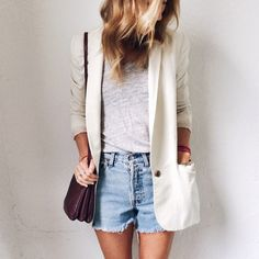 white blazer on white t-shirt with denim cut offs