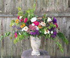 Lisianthus, zinnias, sedum, chrysanthemum, aster, lavender, and Japanese maple branches.    Designed by @fetchingflora