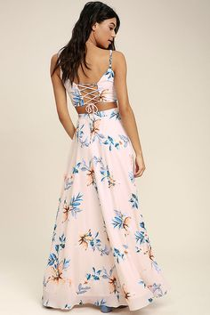 Lulus Exclusive! We've found our happy place in the Barefoot at the Beach Light Peach Print Two-Piece Maxi Dress! Soft and breezy woven poly swings from spaghetti straps to a wide-cut crop top with a lace-up back, and a blue, peach, and white floral print. Pair with the high-waisted maxi skirt boasting a full A-line silhouette and sexy side slit. Elastic at back for fit, and hidden zipper.