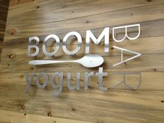 We found this on Pinterest and loved the mix of reclaimed wood and smooth metal that makes this sign cool.