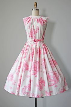 ♛The Details ca. late 1950s dress of a light, crisp, and machine-washable whipped crepe in classic pink and white French Provincial toile. Dancing couples, maidens churning butter, men serenading women, plus boats, old buildings in disrepair, urns, sheep, dogs, horses...a spring or summer