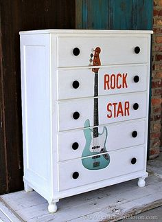 Can you say Rock Star? This chest does...and in the most awesome way! Learn how to get this look at Petticoat Junktion...the blog. Super simple trick!  #rockstar #painted #furniture