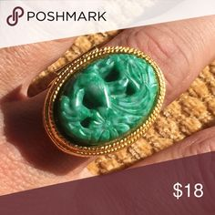 Vintage Green Avon Carved Poison Ring gold opens Beautiful vintage jade green carved poison ring that opens up so you can use it as a locket or for solid perfume or whatever you like. Adjustable so it can fit any size. Vintage Avon. Avon Jewelry Rings
