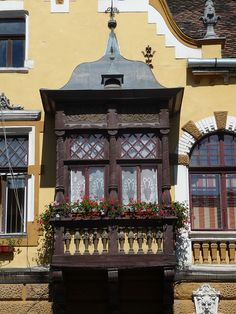 WOODEN BALCONY IN OLD ROMANIAN CITY OF SIGHISOARA