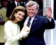 """Jacqueline Kennedy Onassis, wife of the late President Kennedy, embraces brother-in-law Edward Kennedy on July 19, 1986. Kennedy, Democratic senator from Massachusetts, took the helm of one of America's most fabled political families after older brothers John F. Kennedy and Robert Kennedy were assassinated."""