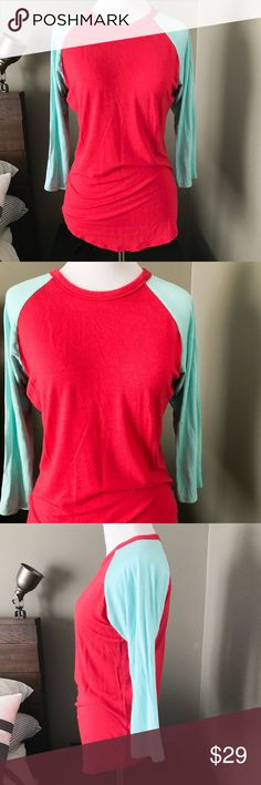 LuLaRoe Randy Baseball Tee Super soft and comfy Randy tee from LuLaRoe. Size XS. Baby blue and bright red. Excellent condition. No damage, no stains. LuLaRoe Tops Tees - Long Sleeve