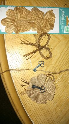 Key to her heart boutonnières. Connect burlap flower with attached ties to bow twig then use twine to make a knot on the top of key for attaching to flower with thread. Burlap flower , bow twig and twine from hobby lobby. Key from lifeway Christian store. Made for my daughters wedding.