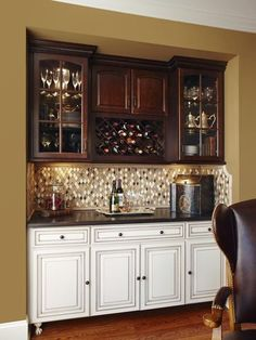 Switch paint/stain treatment. Upper cabinets in cream-weathered finish. Base cabinets in dark stain finish