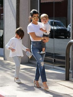 Unit: Her boys were casually dressed in long-sleeved tops, sweatpants and slip-on canvas s...