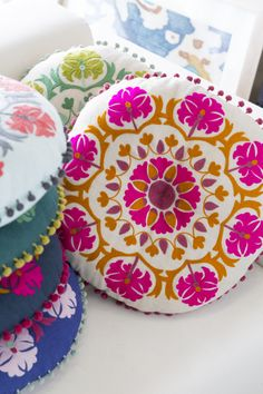 Surya - Suzani Pillows (AR-135 to AR-141) - Crafted of 100% linen, these brightly colored Suzani-inspired pillows feature floral motif appliqués and coordinating pom pom trim to inject personality and color, along with a hint of eclectic style, into any living space - Showroom: Showplace 4100 #hpmkt