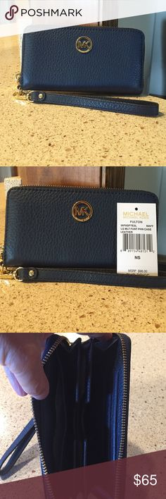 Michael Kors  multi function phone case Michael Kors  multi function phone case leather excellent condition used once or twice perfect for day trips or traveling-spaces for  money, ID, credit cards, and phone Michael Kors Bags Clutches & Wristlets