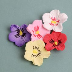 """Representing """"thoughts of love"""" Pansies are a perfect way to show love at weddings, birthdays and other celebrations. These beautiful Pansy flowers are readymade by hand from gumpaste. Gumpaste flower"""