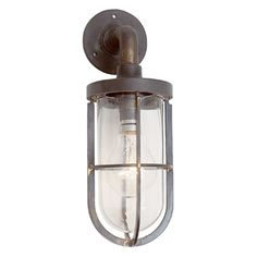 This miniature exterior light is wall mounted and comes in an antique brass finish. Can be used outside. Made in England. Code: LI170