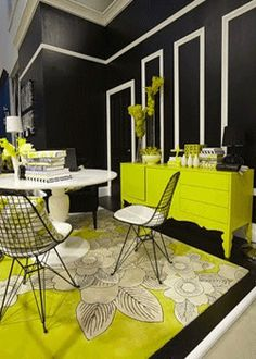 decorating a store front with black white lime | Black walls with white accents, furniture and floor rug in yellowish ...