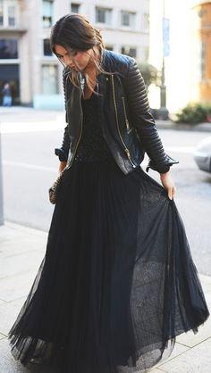 Street style vaporous skirt and leather jacket