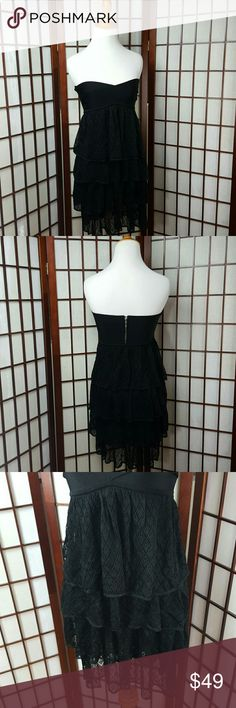 "Strapless BEBE Tiered Lace Dress Size S Preowned excellent condition  BEBE size small Little black dress Strapless Dress Tiered style dress Mini dress Made of rayon and Spandex Stretchable   Measurements  Pit to pit 12-15""  Pit to hem 28"" bebe Dresses Mini"
