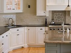 love the island!  white cabinets throughout kitchen, with teal cabinets on island?? love! also love island countertop