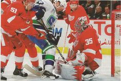 The Wings in 2010/2011 with Howard in net and Filppula and Draper providing support.  .....  PHOTO Getty images in The Hockey News Yearbook. 2011-2012 Ed.