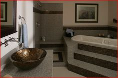 Trend mosaic tile and our exclusive granite are perfect for bathroom remodels.