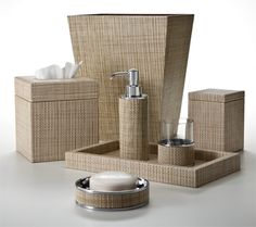 The look of woven rattan, embossed on sandy tan and beige leather. The soap dispenser includes a solid brass pump mechanism plated in polished chrome. The glass holder and soap dish are no longer available. Made in Italy.