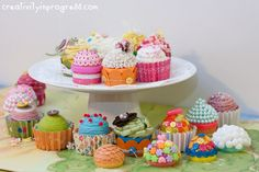 Bright and colorful pretend Easter cupcakes made with cardboard, fabric, buttons, pom poms and jelly beans.