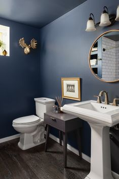 This small powder room is still a show stopper! We saved space by using a pedestal sink and moving the toilet. The bathroom looks chic with all of the gol decor accessories and accents. Dark Blue Bathrooms, Navy Bathroom, Diy Bathroom Decor, Bathroom Interior Design, Blue Bathroom Paint, Small Bathroom Paint Colors, Family Bathroom, Modern Bathroom, Bathroom Ideas