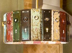 "Old lock ""face plates"" chandelier with light coming out of the key holes, very cool!"